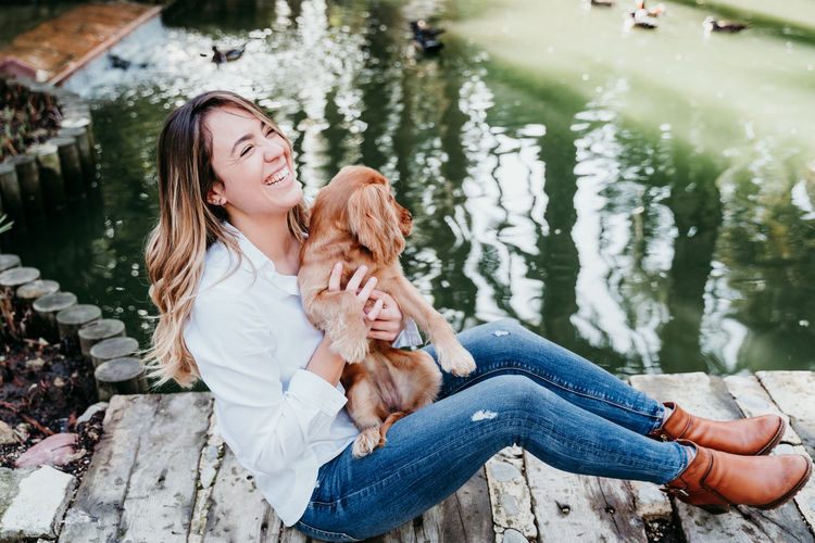 Young woman with dog on water