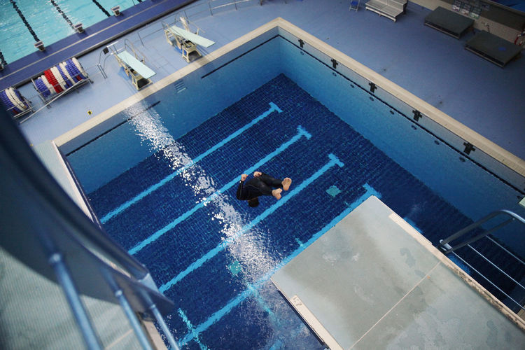 High Angle View Of Young Man Diving In Pool