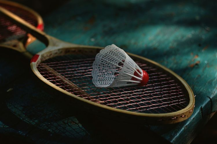 High Angle View Of Shuttle Cock On Racket