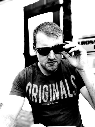 EyeEmSelect Looking At Camera Portrait Mid Adult Sunglasses One Person Front View Day Adult Outdoors Beer Garden Black And White Chilling Posing Summertime Pub Men Serious Adjusting Thinking Cool The Portraitist - 2017 EyeEm Awards EyeEm Selects