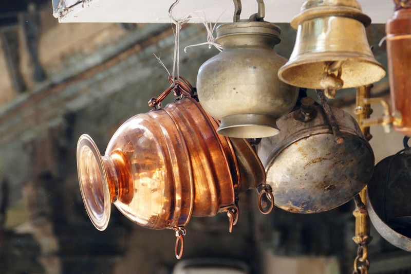 Close-up of old light bulb hanging at market stall