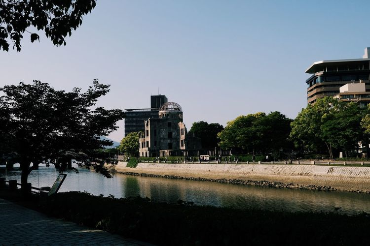 Architecture Building Building Exterior Built Structure City Clear Sky Copy Space Day Growth Nature No People Outdoors Plant Reflection River Sky Tree Water