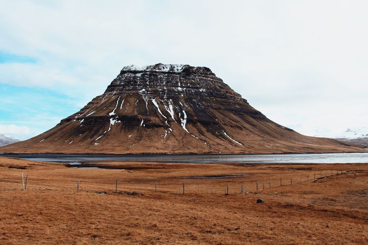 Kirkjufell Kirkjufell Iconic Landscape Mountain Adventure Iceland EyeEmNewHere Sky Beauty In Nature Scenics - Nature Mountain Tranquil Scene Water Land Cloud - Sky Tranquility Nature No People Idyllic Outdoors Environment The Great Outdoors - 2018 EyeEm Awards Travel Destinations