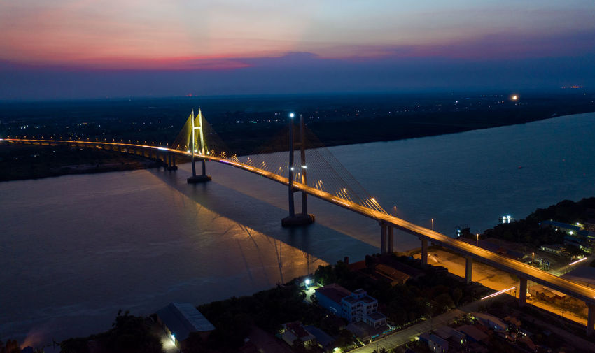 High angle view of illuminated bridge against sky during sunset