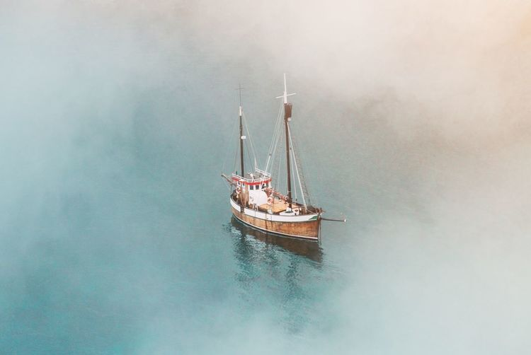High Angle View Of Sailboat Sailing On Sea In Foggy Weather