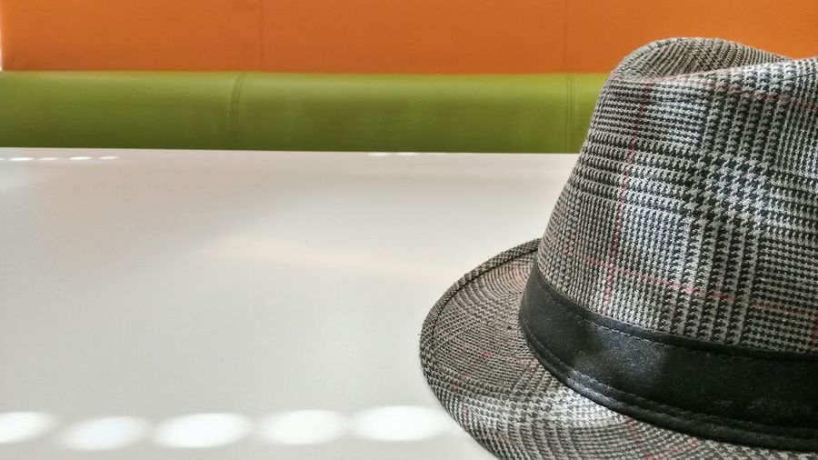 Cropped Image Of Fedora Hat On Table
