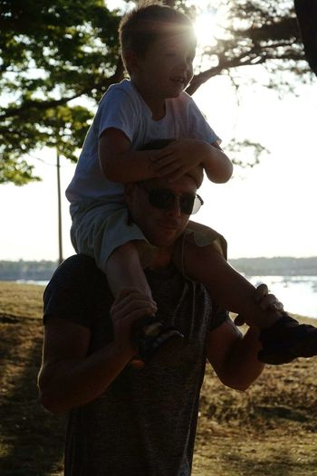 Fatherhood Moments On Shoulders Piggy Back Ride  Golden Hour Beach Portrait Portraiture Daddy And Me Sunshine Sun Face Beach Walk Enjoying Life Family Fun Happiness Explore More Quality Time Autism Autismdad Love Affection Casual Candid Portraits Fresh On Eyeem