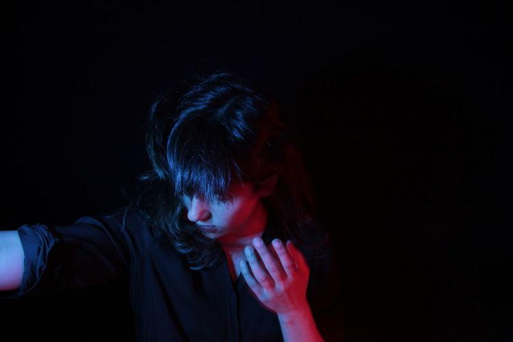 Headshot of woman against black background