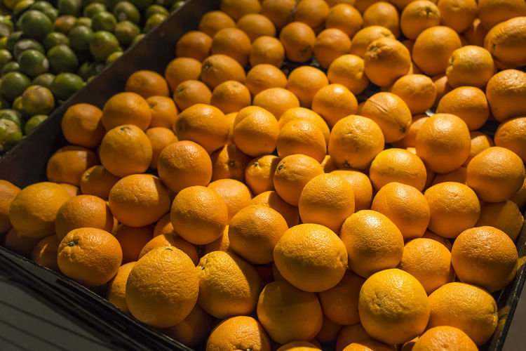 Oranges Food Food And Drink Large Group Of Objects Freshness Healthy Eating Abundance Fruit Wellbeing Still Life For Sale Yellow No People Close-up Retail  Indoors  High Angle View Market Arrangement Citrus Fruit Market Stall Retail Display Orange Oranges