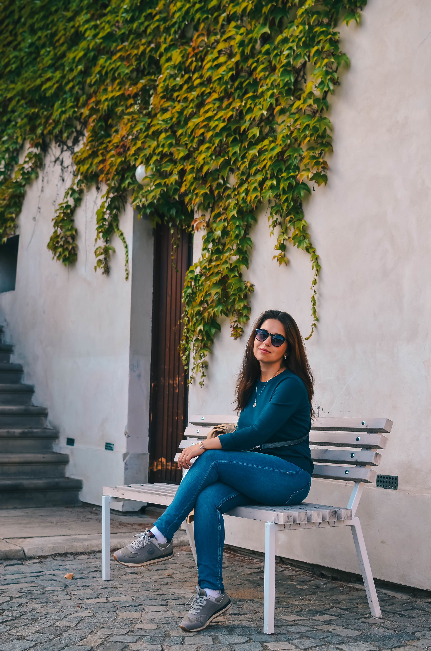 sitting, full length, one person, young adult, real people, casual clothing, young women, leisure activity, lifestyles, seat, beauty, smiling, looking at camera, long hair, beautiful woman, hairstyle, adult, hair, outdoors