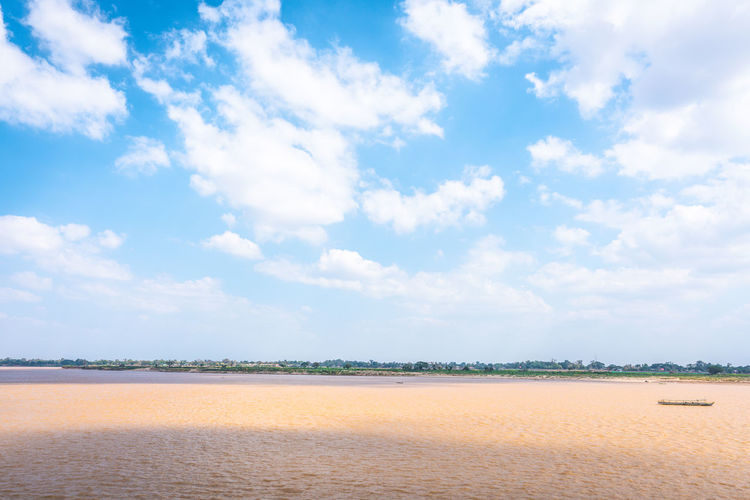 Sky Cloud - Sky Scenics - Nature Beauty In Nature Land Tranquil Scene Tranquility Sand Day Nature Landscape Beach Non-urban Scene No People Blue Environment Outdoors Water Idyllic Salt Flat Arid Climate River