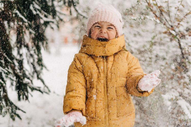 Portrait of girl standing in snow