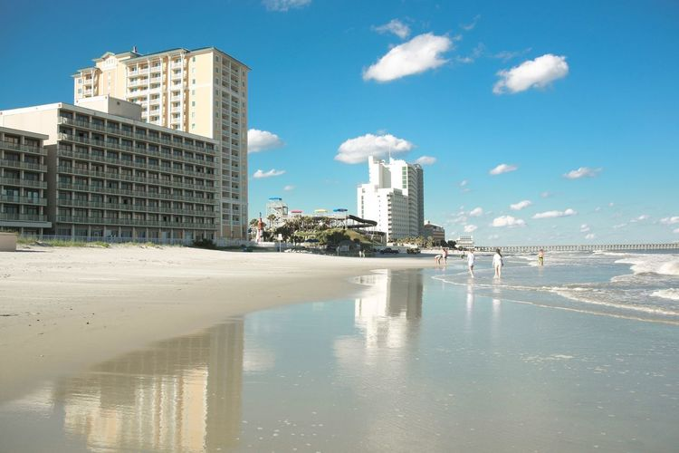 Beachfront BEACH!  Beach View Beachphotography Architecture Built Structure Skyscraper Sky Water Beach Reflection Waterfront Day Sea City Cityscape Sand Outdoors Modern Nature