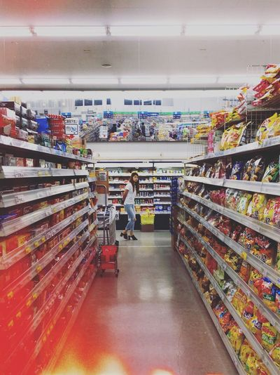 Store Retail  Supermarket Choice Shelf Shopping Variation Business Order Market Indoors  Arrangement Small Business Consumerism Food And Drink Large Group Of Objects Diminishing Perspective Multi Colored Still Life Abundance