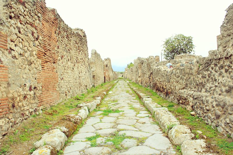 The Way Forward Clear Sky Walkway Diminishing Perspective Pathway Surface Level Footpath Narrow Day Outdoors Vanishing Point Sky Long No People Tranquility Tranquil Scene Dirty Green Green Color Beauty In Nature Pompeii  Italy Battle Of The Cities