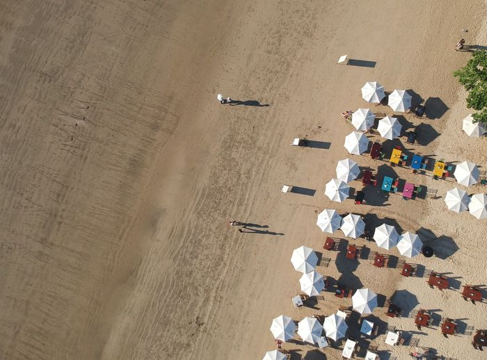 High angle view of deck chairs on beach