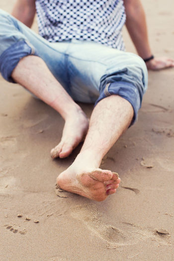 Low section of man on sand
