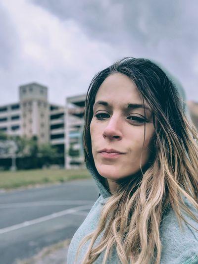 EyeEm Selects City Young Women Portrait Beautiful Woman Headshot Long Hair Beauty Women Sky Architecture