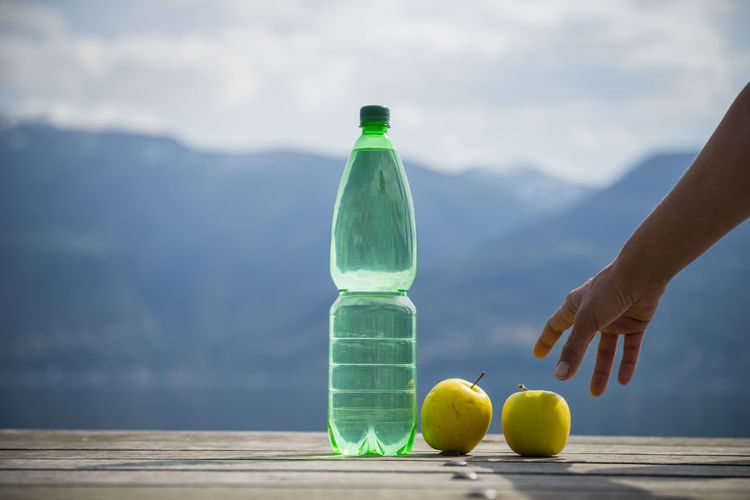 Woman hand take an apple and water bottle Apple - Fruit Bottle Cloud - Sky Cold Drink Color Day Food Fruit Healthy Eating Holding Human Arm Human Body Part Human Hand Human Limb Mountain Nature One Person Outdoors People Sky Take Water Water Bottle  Woman Young Adult