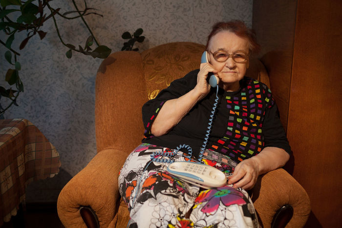 Alone Answer Call Caucasian Communicate Glasses Grandmother Home Look Old Phone Senior Woman