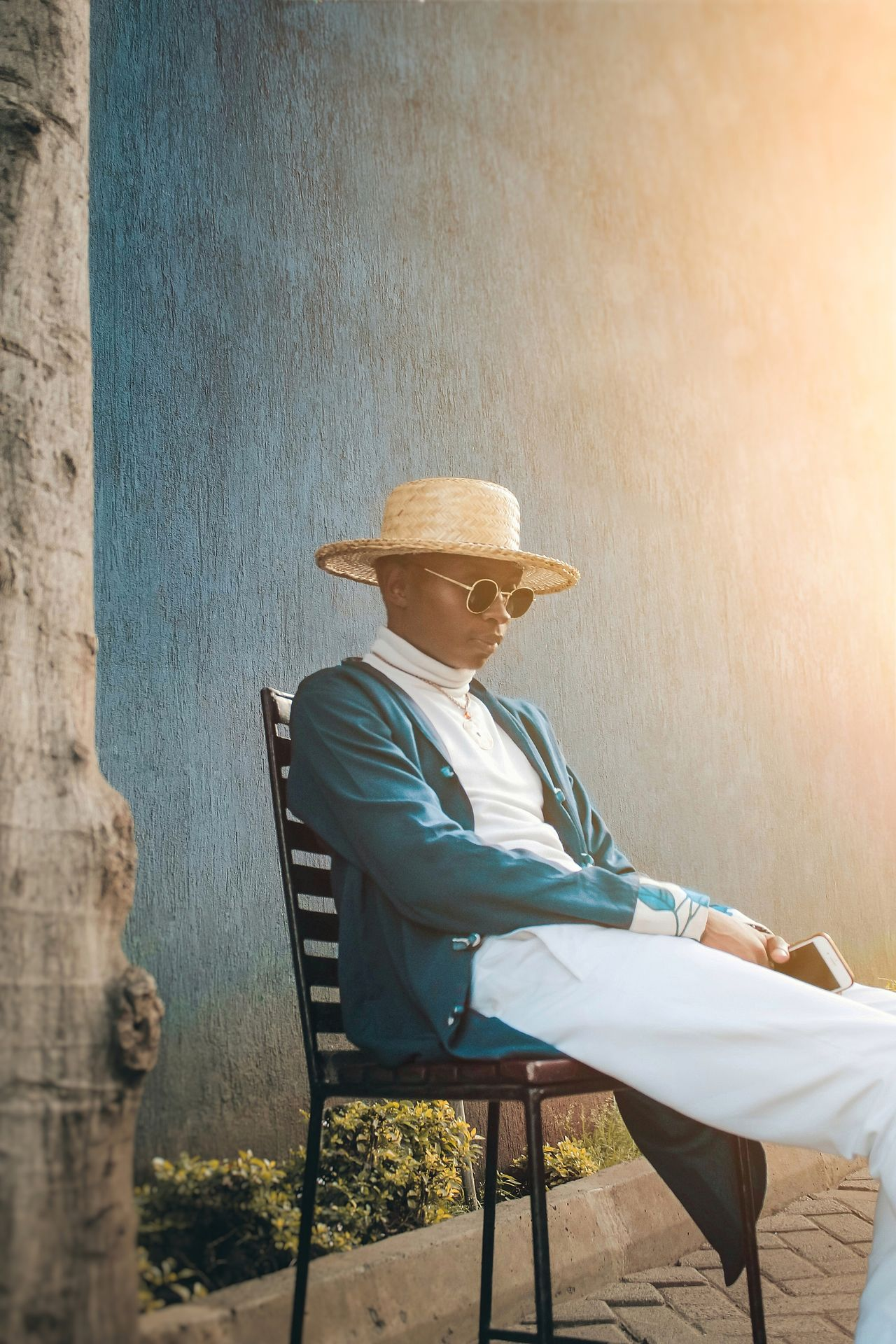 Man wearing hat while sitting on chair