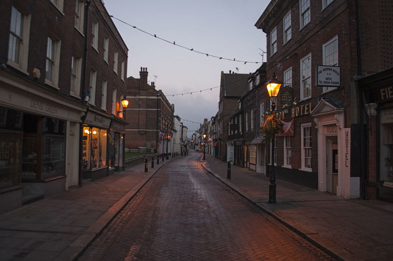 The high street in Rochester, Kent, England, early in the morning. British Medway Rochester, Kent Architecture Building Building Exterior Built Structure City Dickens Diminishing Perspective Dusk Early Morning England English Illuminated Light Residential District Road Street Street Light Street Scene The Way Forward