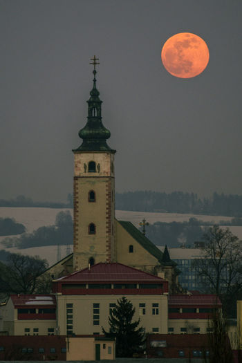 supermoon Building Exterior Architecture Built Structure Sky Moon Full Moon Building Nature Night Tower Space No People Place Of Worship Astronomy Religion Cloud - Sky Belief City Outdoors Planetary Moon Spire  Moonlight Bloodmoon 2019 February