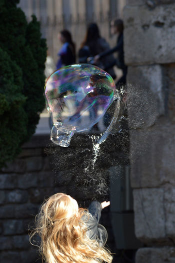 Rear view of woman at bubbles