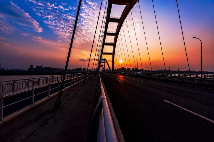 Silhouette Fuyuan Lu Bridge Over River Against Sky During Sunset