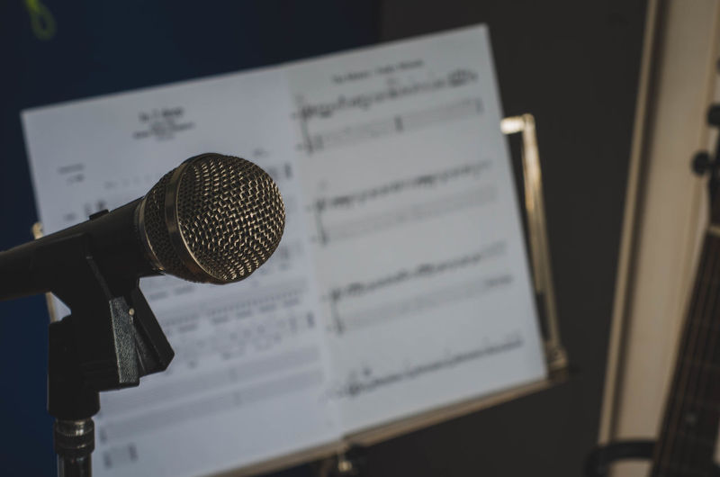 Close-up of microphone with musical note in background
