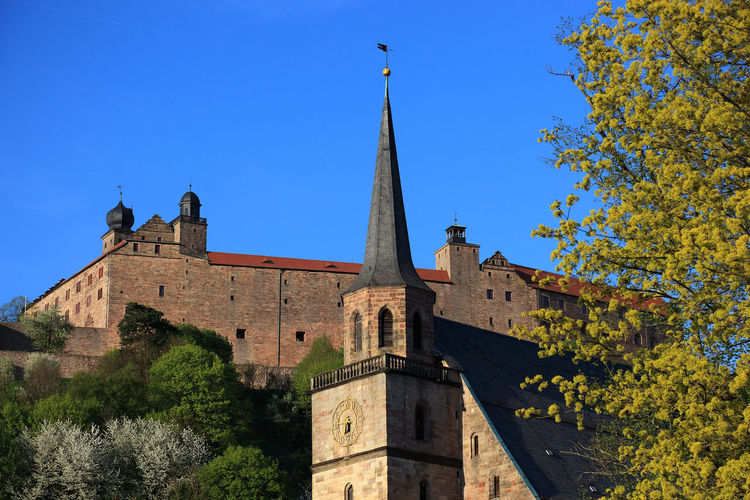 old city and castle Plassenburg and church Petrikirche of Kulmbach, Frankonia, Bavaria, Germany Architecture Belief Blue Building Building Exterior Built Structure Clear Sky Day History Kulmbach Low Angle View Nature No People Outdoors Place Of Worship Plant Plassenburg Religion Sky Spire  Spirituality The Past Tower Tree