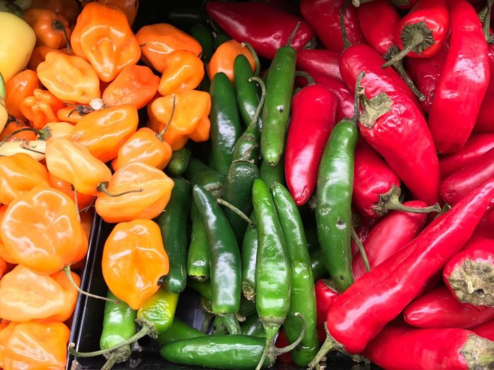 Close-up of multi colored chili peppers for sale in market
