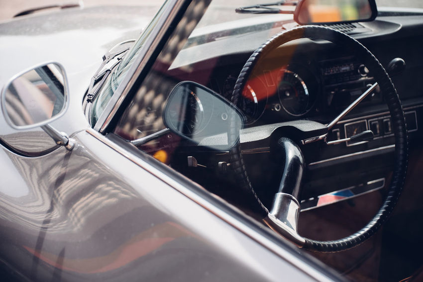 Retro Styled Door Car Interior Car Vintage Collector's Car Wheel Retro Styled Vintage Car Windshield Vehicle Interior Steering Wheel Windscreen Car Point Of View Side-view Mirror Vehicle Part Dashboard Windshield Wiper Rear-view Mirror Speedometer Vehicle Mirror Gearshift Vehicle Seat