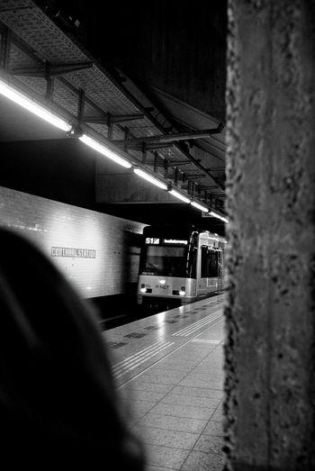 Train at railroad station platform at night