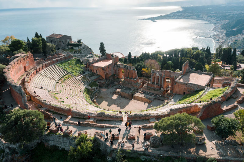 Aerial drone shot of the ancient greek theatre of taormina, theatre seen from above