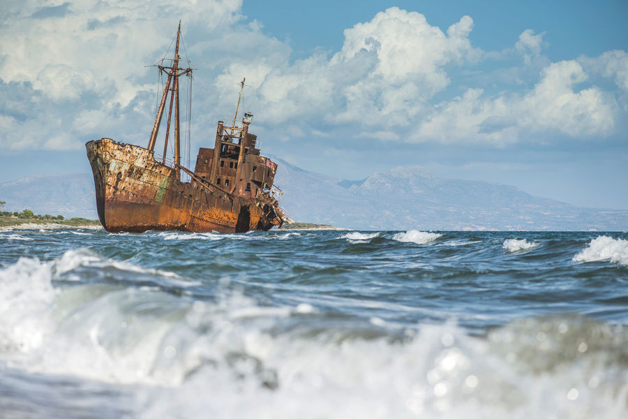 Abandoned Beach Boat Calm Cold Environmental Conservation Famous Place Horizon Over Water Mode Of Transport Nautical Vessel Ocean Outdoors Power In Nature Rippled Sea Shore Voyage Water Waterfront Wave