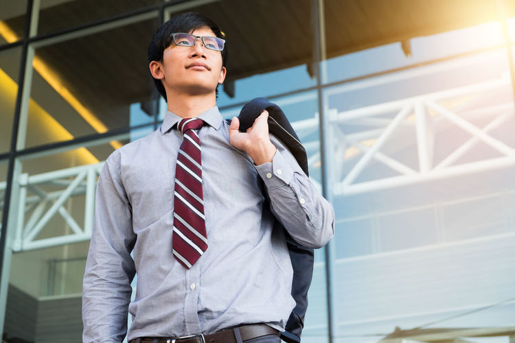 Businessman Wearing Eyeglasses While Standing Outdoors