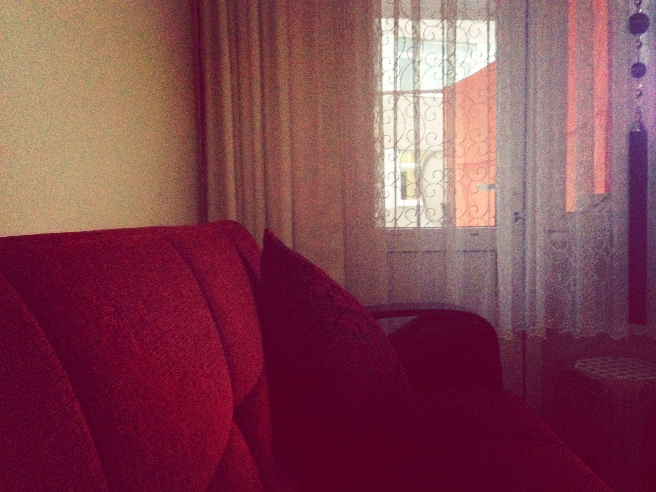 indoors, window, home interior, curtain, bed, red, bedroom, relaxation, sofa, domestic room, house, fabric, textile, sunlight, built structure, chair, comfortable, absence, architecture, day