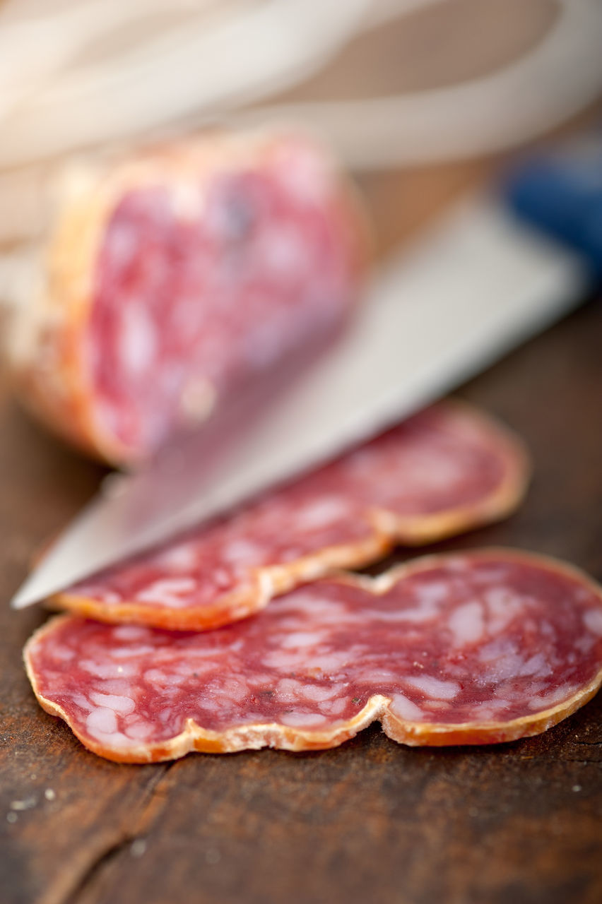 Close-Up Of Salami On Table
