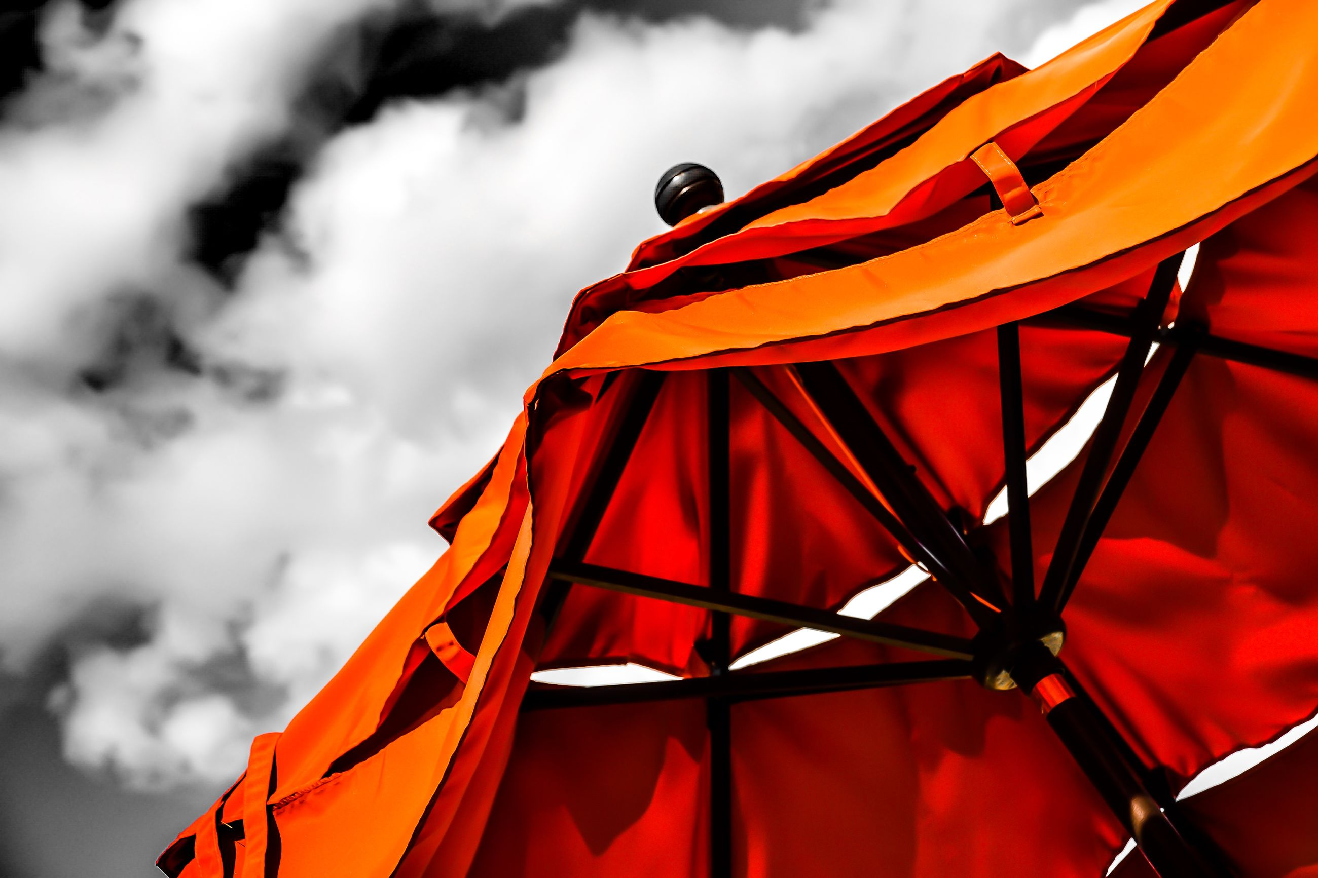 sky, red, transportation, cloud - sky, mode of transport, cloudy, flying, part of, cloud, orange color, travel, low angle view, nautical vessel, outdoors, no people, day, mid-air, multi colored, nature, close-up