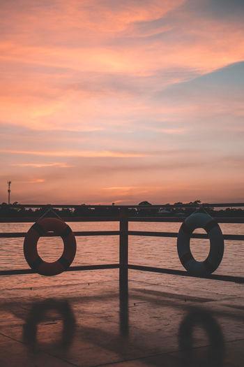 Sunset Sky Water Orange Color Scenics - Nature Cloud - Sky Sea Nature Beauty In Nature Tranquility Tranquil Scene No People Idyllic Land Outdoors Beach Circle Geometric Shape Shape Wheel