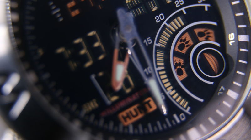 Macro close up of a tactical digital watch face functioning Time Seconds Hour Watch Digits Digital Display Liquid-crystal Display Fishing Gear Compass Magnetic North Chrome Chronograph Digital Watch Casio Timer Hunting Stopwatch Hands Mineral Glass Sapphire Crystal Casio Outdoor Gear Luminous After Glow