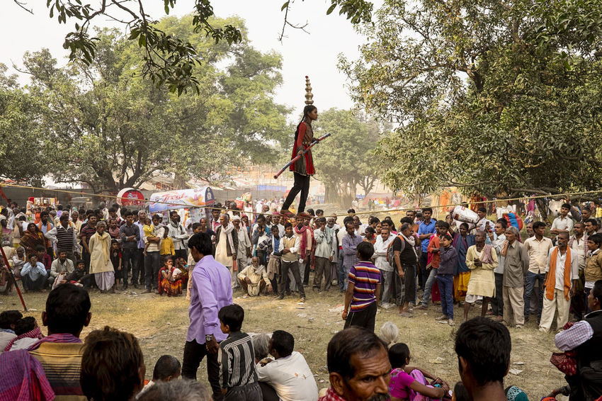 A young lady balances on a tightrope whilst being watched by a large crowd at Sonepur Mela, Bihar Balance Bihar Crowd Day Enjoyment Entertainer Festival Festivals Hajipur India Large Group Of People Outdoors Real People Sonepur Sonepurmela Tightrope Tightrope Walking Travel Travel Photography Watching