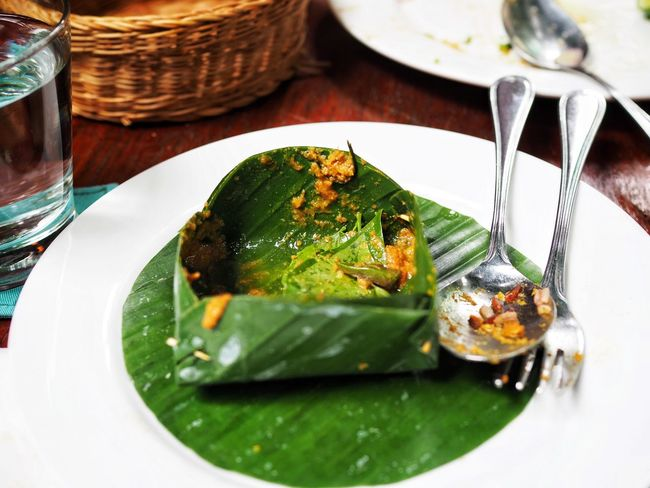 Empty plate banana leaf Plate Fork Food And Drink Indoors  Food Table No People Freshness Ready-to-eat Green Color Healthy Eating Close-up Cambodian Food Khmer Food Amok Place Setting Banana Leaf Bowl Cambodia Food And Drink Indulgence Banana Leaf Travel Curry