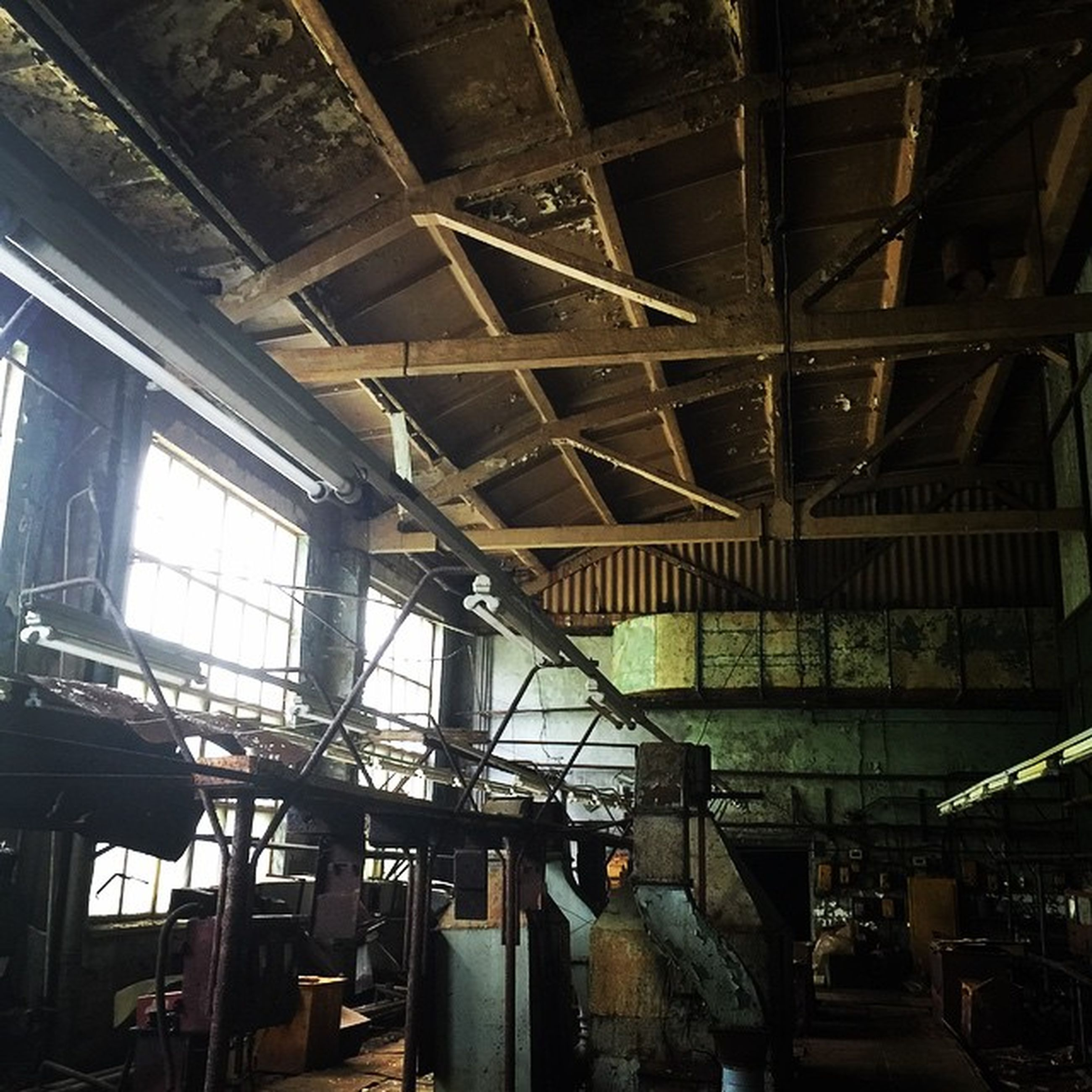 indoors, ceiling, interior, architecture, built structure, window, abandoned, low angle view, old, chair, damaged, obsolete, glass - material, absence, empty, skylight, no people, day, run-down, deterioration