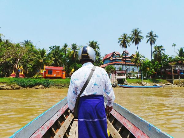 On my way. Palm Tree Clear Sky Outdoors Person Rear View Myanmar Mwalamyine Little Island Boat Trip Casual Clothing Traditional Clothing Helmet On My Way Here I Come Summertime Color Photography Color Of Life