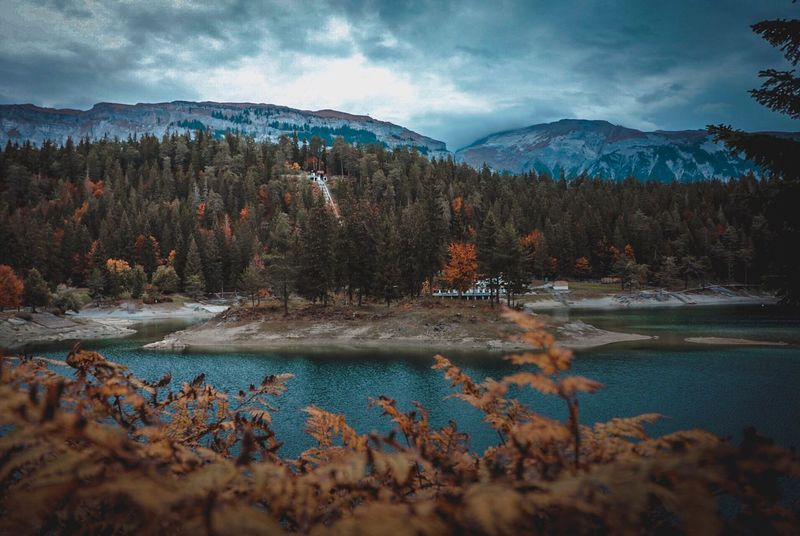 Autumn at the lake Cauma in Flims Graubünden Flims Laax Switzerland Caumasee Mountain Plant Beauty In Nature Scenics - Nature Cold Temperature Water A New Beginning Tree Sky Cloud - Sky Nature Mountain Range Lake Non-urban Scene No People Outdoors A New Beginning