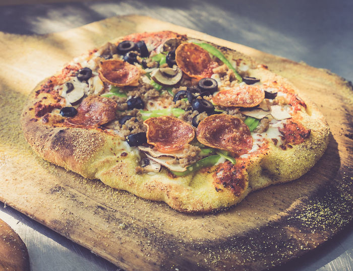 Close-up of pizza on cutting board