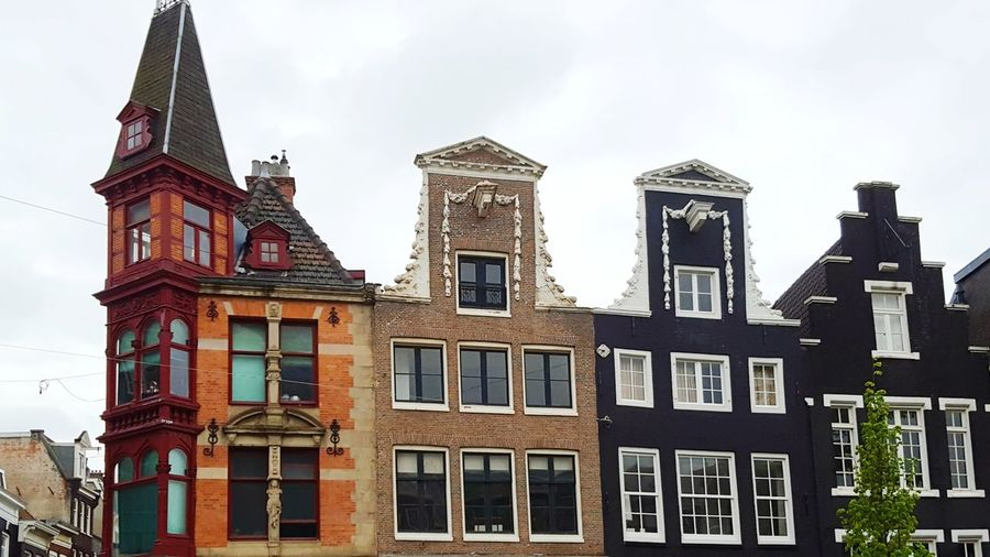 Architecture Building Exterior Window No People Outdoors Day City Taking Pictures Travel Photography Netherlands Amsterdam Architecture City City Life Olanda Travel Enjoying Life Traveling PhonePhotography Colorful Amsterdamcity House Home Building