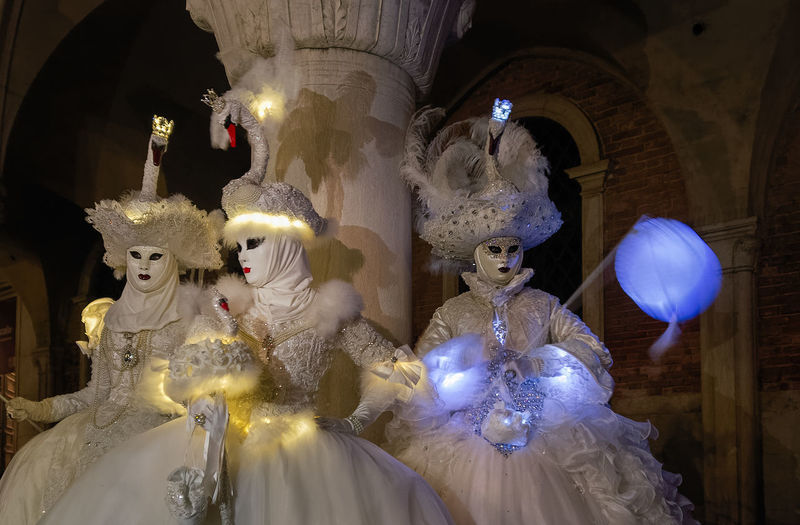 Carnival HUAWEI Photo Award: After Dark Venice, Italy Architecture Art And Craft Belief Building Built Structure Creativity Female Likeness Human Representation Illuminated Lamps Mask - Disguise Place Of Worship Representation Shadow Spirituality Statue Swan The Art Of Street Photography